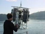 photo of scientist with sampling equipment